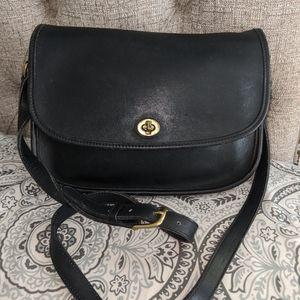 Coach vintage black leather turnlock saddle bag
